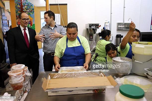S Labor Secretary Thomas Perez and La Cocina executive director Caleb Zigas tour the kitchen at La Cocina on January 22 2014 in San Francisco...