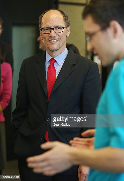 S Labor Secretary Thomas Perez chats with trainees at the Siemens training facility on October 28 2014 in Berlin Germany Secretary Perez visited the...