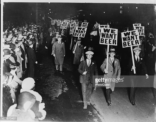 Labor union members marching through Broad Street carrying signs reading 'We Want Beer' in protest of prohibition Newark New Jersey October 31 1931