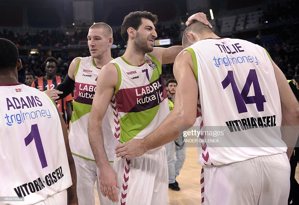 Laboral Kutxa's centre <a gi-track='captionPersonalityLinkClicked' href=/galleries/search?phrase=Colton+Iverson&family=editorial&specificpeople=5663882 ng-click='$event.stopPropagation()'>Colton Iverson</a>, Georgian forward <a gi-track='captionPersonalityLinkClicked' href=/galleries/search?phrase=Tornike+Shengelia&family=editorial&specificpeople=8205152 ng-click='$event.stopPropagation()'>Tornike Shengelia</a> and French forward Kim Tillie celebrate their victroy at the end of the Euroleague group basketball match Laboral Kutxa Vitoria vs Unicaja Malaga at the Fernando Buesa Arena sportshall in Vitoria on February 13, 2015. Laboral Kutxa's won 79-74.