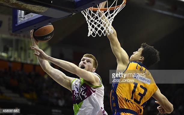 Laboral Kutxa's Latvian forward Davis Bertans vies with Valencia's Serbian forward Vladimir Lucic during the Euroleague group D basketball match...