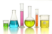 Laboratory glassware with colored liquids over white background - With Clipping Path