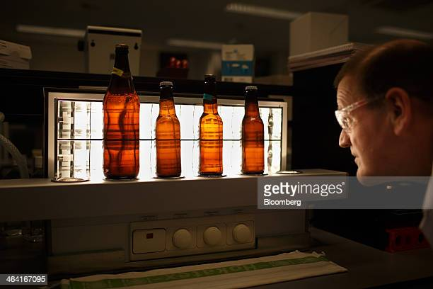 A laboratory technician checks the clarity of bottled beer during enzyme testing at the Royal DSM NV laboratory in Delft Netherlands on Monday Jan 20...