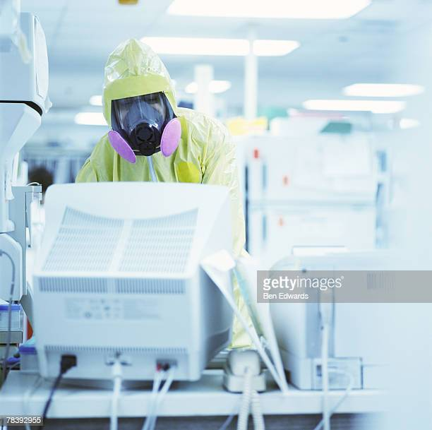 Laboratory technician in a clean suit