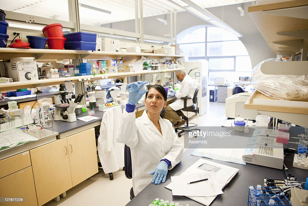 Laboratory technicians at work in modern lab : Stock Photo
