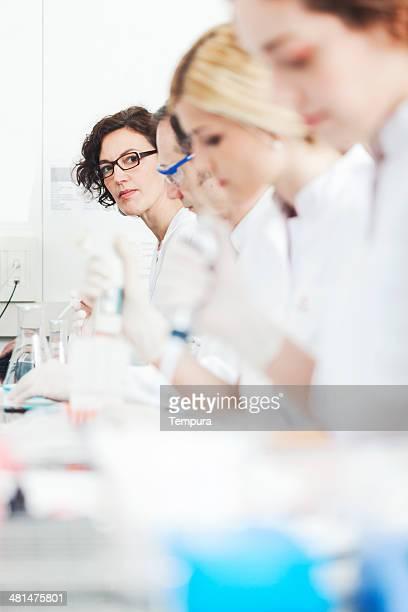 Laboratory technicians doing reserah work.