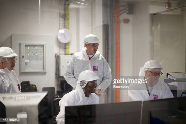 Laboratory technicians look at screens in the central operating room as they monitor data from a yeast extract drying chamber at the Royal DSM NV...