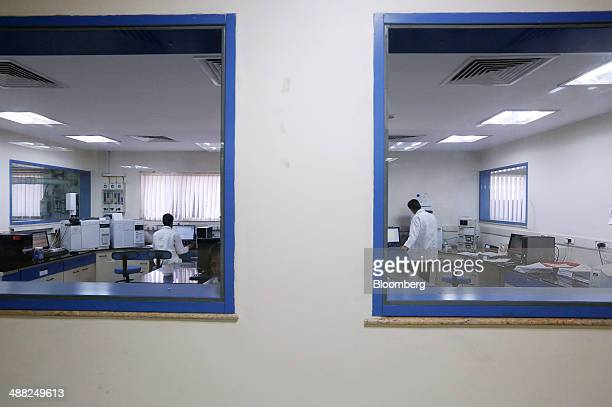 Laboratory technicians work in a quality control laboratory at the Himalaya Drug Co campus in Bangalore India on Thursday January 9 2014 India's...