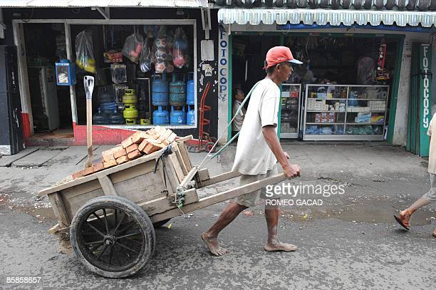 A laborer delivers construction materials in Jakarta on April 8 2009 on the eve of Indonesia's parliamentary elections The new government will have...