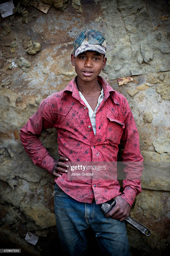 A laborer is taking a rest by the rocks on Chittagong beach where mega ships have been left abandoned for disassembling by poor workers Where do the...