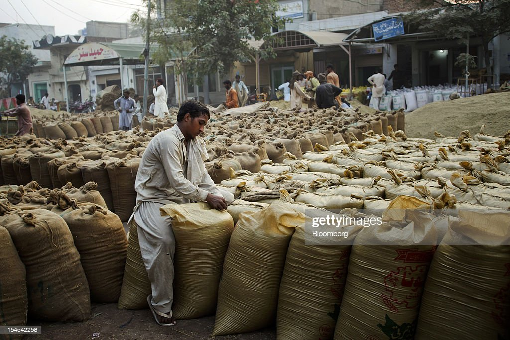 A laborer seals a bag of rice at a rice market in the Chiniot district of Punjab province, Pakistan, on Saturday, Oct. 13, 2012. Rice exports from Pakistan, the fourth-largest shipper, are set to rebound from November with the new harvest after a rally in domestic prices and cheaper supplies from India cut shipments, a traders' group said. Photographer: Asad Zaidi/Bloomberg via Getty Images