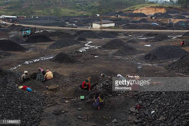 Laborers break coal into smaller pieces in the Jaintia hills of Meghalaya India on Friday April 1 2011 Coal will continue to play a major role in new...
