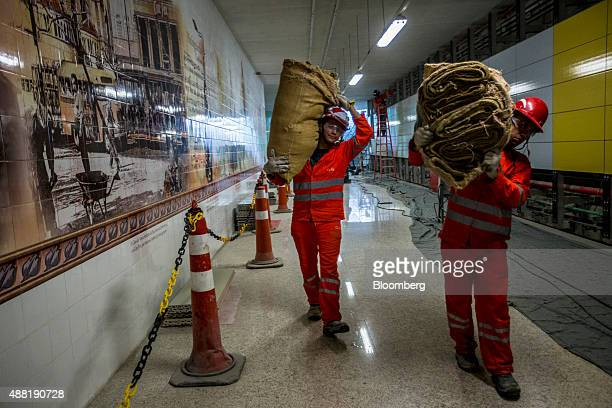 Laborers carry supplies during construction at the Nossa Senhora da Paz metro station on the 4 Line of the subway system in Rio de Janeiro Brazil on...