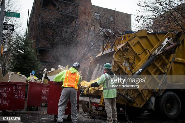 Laborers for a demolition company load structural material taken out of a former laboratory belonging to the Long Island College Hospital in the...