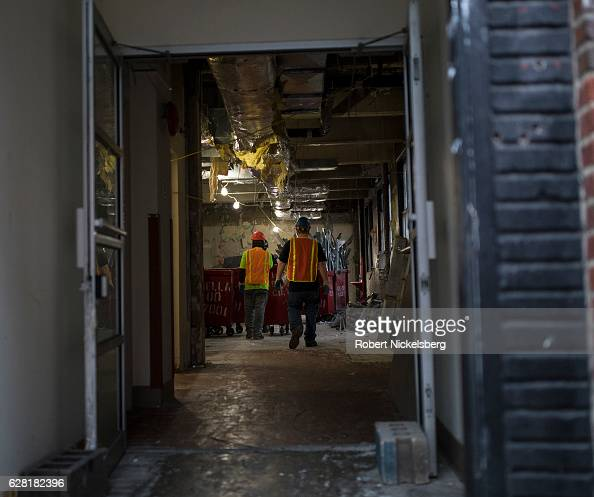Laborers for a demolition company load structural material taken out of a former laboratory belonging to the Long Island College Hospital LICH in the...