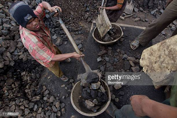 Laborers load containers with coal in the Jaintia hills of Meghalaya India on Friday April 1 2011 Coal will continue to play a major role in new...