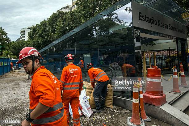 Laborers work near the entrance to the Nossa Senhora da Paz metro station on the 4 Line of the subway system in Rio de Janeiro Brazil on Friday Sept...