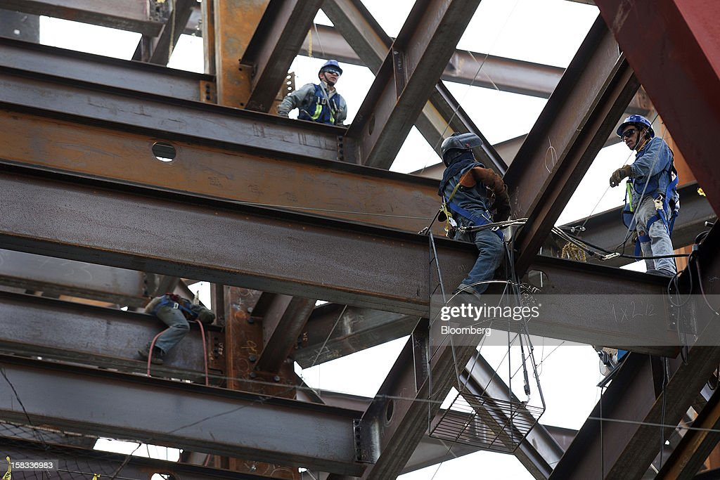 Laborers work on steel beams at the construction site of the BBVA Bancomer Tower in Mexico City, Mexico, on Thursday, Dec. 13, 2012. The office for BBVA Bancomer, the Mexican unit of Banco Bilbao Vizcaya Argentaria SA, Spain's second-biggest bank, will have 50 floors and accommodate about 4,500 employees when it is completed. Photographer: Susana Gonzalez/Bloomberg via Getty Images