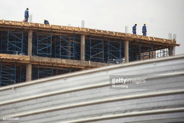 Laborers work on the upper floor of the Cit des Affaires de N'Djamena construction site in N'Djamena Chad on Wednesday Aug 16 2017 African...