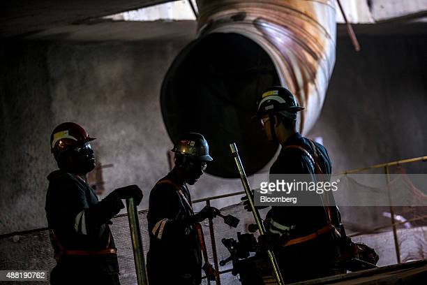 Laborers work underground during the construction of the Nossa Senhora da Paz metro station on the 4 Line of the subway system in Rio de Janeiro...
