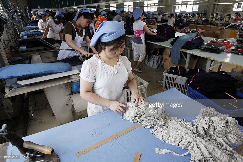 Labors work at a clothing factory on August 1, 2011 in Huaibei, Anhui Province of China. China's Manufacturing sector Purchasing Managers Index (PMI) fell to 50.7 percent in July from 50.9 in June, a 29-month record low since March of 2009, according to the China Federation of Logistics and Purchasing (CFLP) on Monday.