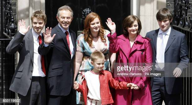 Labour 70 Prime Minister Tony Blair accompanied by his family pose on the steps of No10 as they leave Downing Street London for the final time