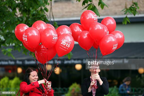Labour activists prepare balloons ahead of the arrival of Labour leader Ed Miliband in Crouch End on April 16 2015 in London England The Labour...