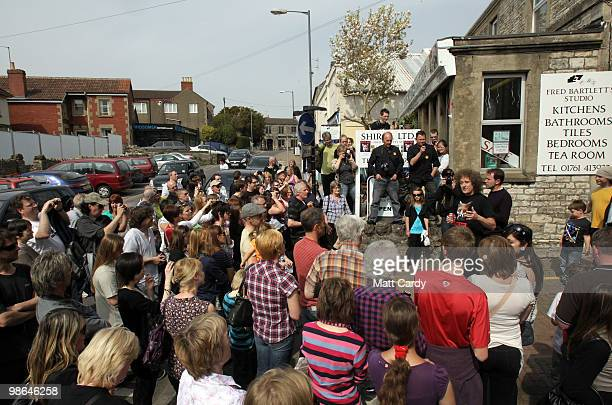 Labour candidate Dan Norris and Brian May founding member of the rock band Queen speak with people outside a cafe on the High Street on April 24 2010...