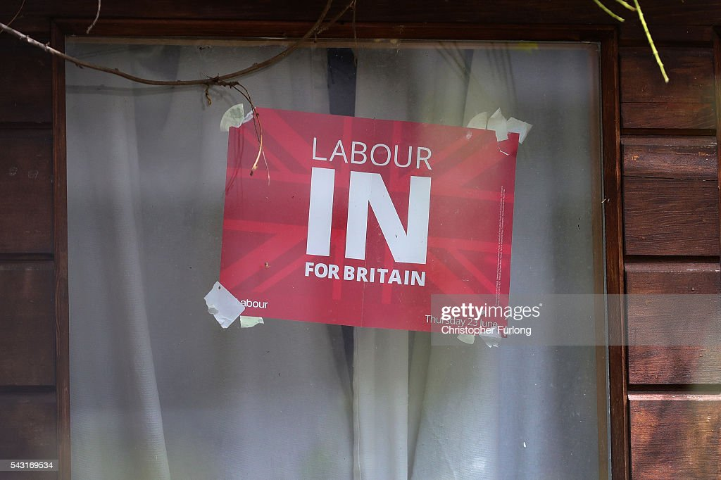 A 'Labour In' campaign poster is stuck to the window at the home of Labour Leader Jeremy Corbyn in North London as resignations from his shadow cabinet continue on June 26, 2016 in London, England. In the wake of shadow foreign secretary Hilary Benn being fired by Corbyn, Twelve members of the Labour shadow cabinet have resigned today.