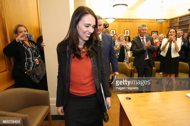 Labour leader and prime ministerelect Jacinda Ardern receives a standing ovation as she arrives at a caucus meeting at Parliament on October 20 2017...