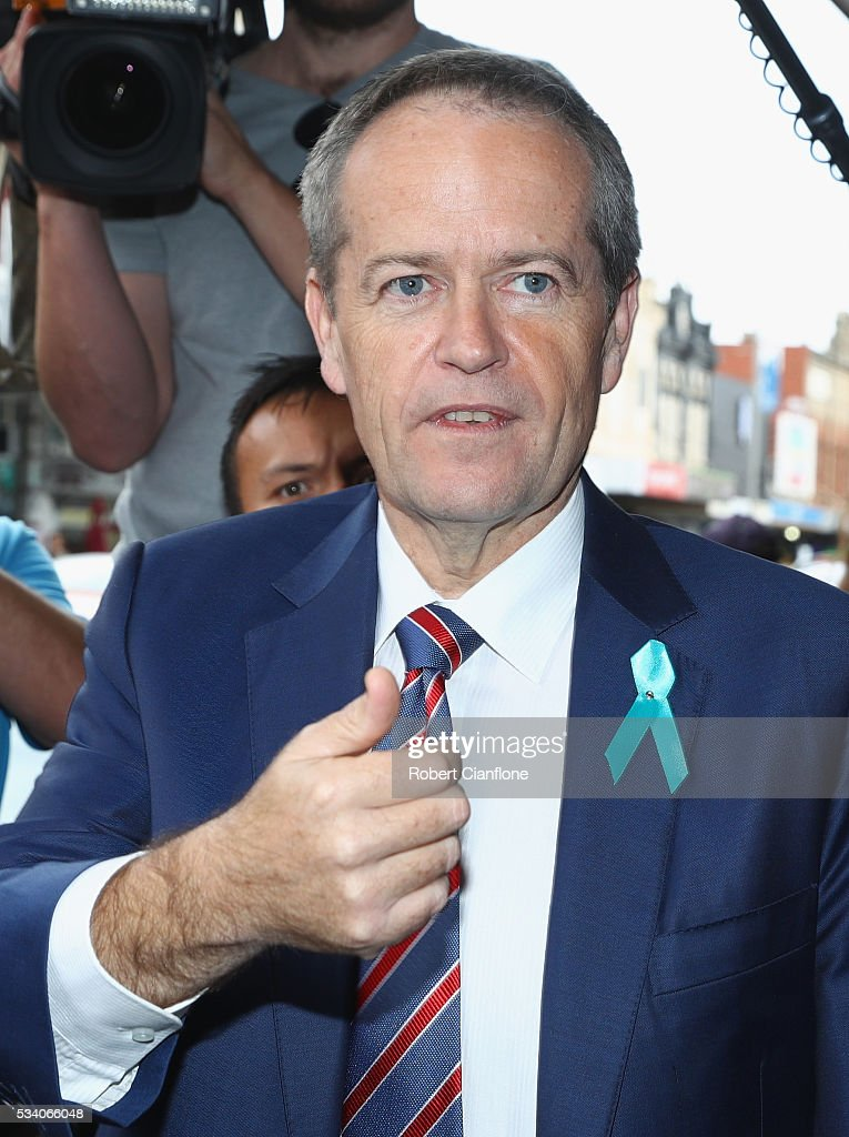 Labour leader <a gi-track='captionPersonalityLinkClicked' href=/galleries/search?phrase=Bill+Shorten&family=editorial&specificpeople=606712 ng-click='$event.stopPropagation()'>Bill Shorten</a> is seen during a street walk on May 25, 2016 in Melbourne, Australia. A Queensland bank has threatened legal action over Mr Shorten's 'putting people first' campaign slogan, which they believe gives people the impression the bank is affiliated with the Labor party.