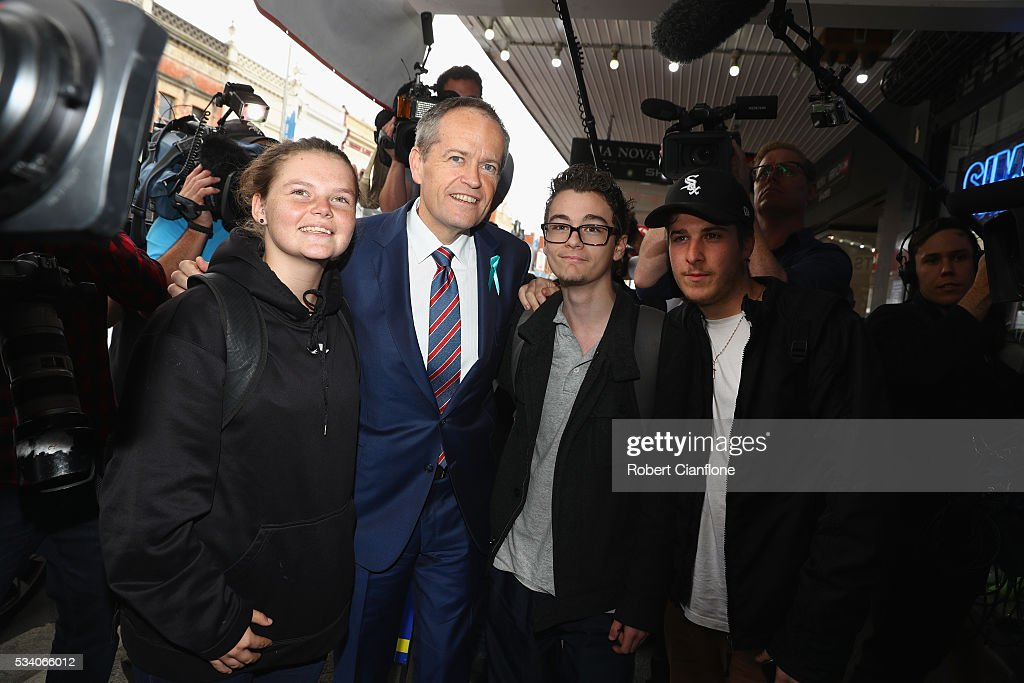 Labour leader <a gi-track='captionPersonalityLinkClicked' href=/galleries/search?phrase=Bill+Shorten&family=editorial&specificpeople=606712 ng-click='$event.stopPropagation()'>Bill Shorten</a> poses for a photo with locals during a street walk on May 25, 2016 in Melbourne, Australia. A Queensland bank has threatened legal action over Mr Shorten's 'putting people first' campaign slogan, which they believe gives people the impression the bank is affiliated with the Labor party.