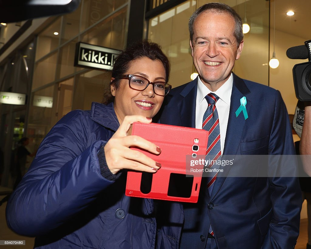 Labour leader Bill Shorten poses for a selfie wih a local during a street walk on May 25, 2016 in Melbourne, Australia. A Queensland bank has threatened legal action over Mr Shorten's 'putting people first' campaign slogan, which they believe gives people the impression the bank is affiliated with the Labor party.