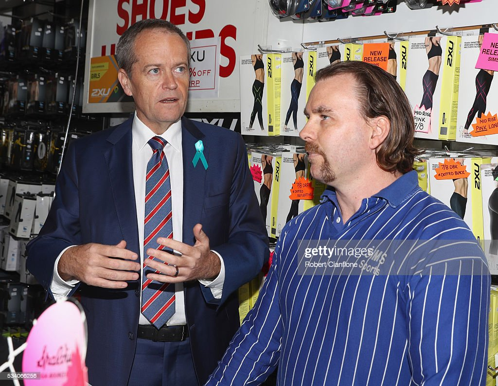 Labour leader Bill Shorten speaks to a local business owner during a street walk on May 25, 2016 in Melbourne, Australia. A Queensland bank has threatened legal action over Mr Shorten's 'putting people first' campaign slogan, which they believe gives people the impression the bank is affiliated with the Labor party.