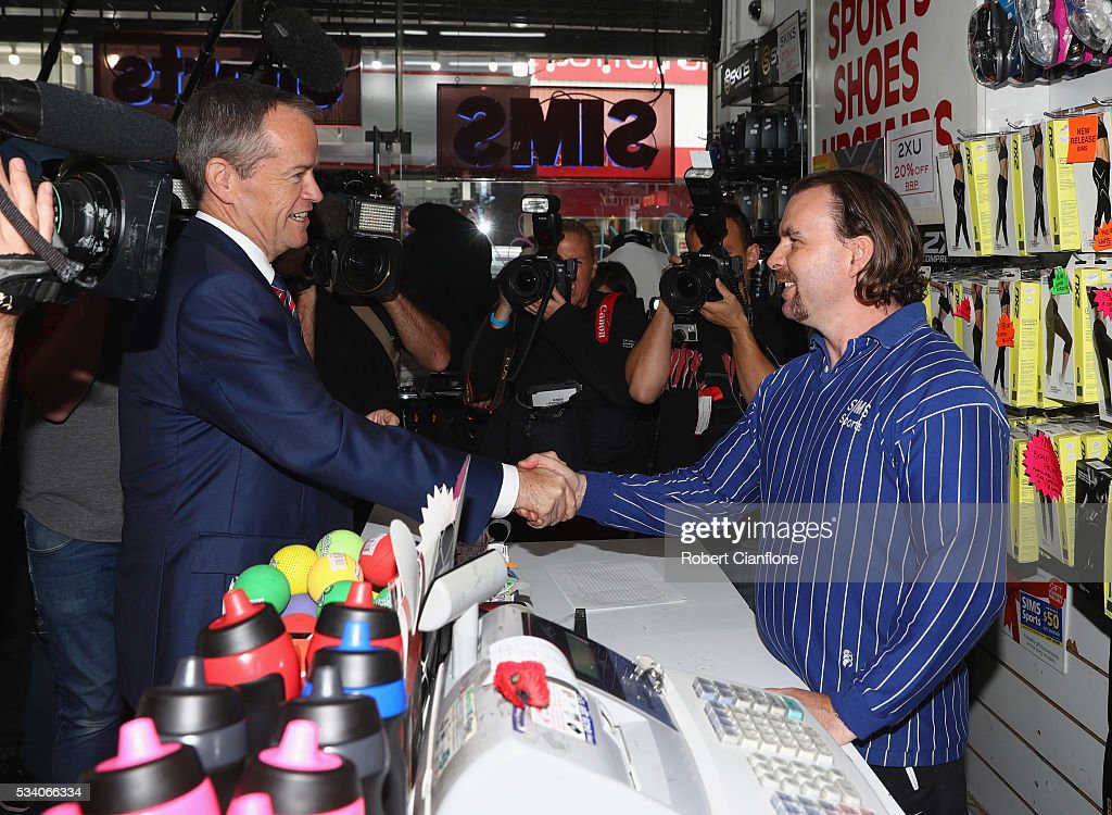 Labour leader <a gi-track='captionPersonalityLinkClicked' href=/galleries/search?phrase=Bill+Shorten&family=editorial&specificpeople=606712 ng-click='$event.stopPropagation()'>Bill Shorten</a> speaks to a local business owner during a street walk on May 25, 2016 in Melbourne, Australia. A Queensland bank has threatened legal action over Mr Shorten's 'putting people first' campaign slogan, which they believe gives people the impression the bank is affiliated with the Labor party.
