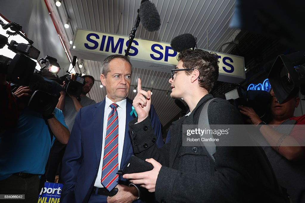 Labour leader <a gi-track='captionPersonalityLinkClicked' href=/galleries/search?phrase=Bill+Shorten&family=editorial&specificpeople=606712 ng-click='$event.stopPropagation()'>Bill Shorten</a> speaks to a local during a street walk on May 25, 2016 in Melbourne, Australia. A Queensland bank has threatened legal action over Mr Shorten's 'putting people first' campaign slogan, which they believe gives people the impression the bank is affiliated with the Labor party.