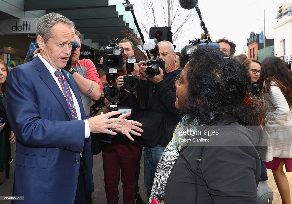 Labour leader Bill Shorten speaks to a locals during a street walk on May 25, 2016 in Melbourne, Australia. A Queensland bank has threatened legal action over Mr Shorten's 'putting people first' campaign slogan, which they believe gives people the impression the bank is affiliated with the Labor party.