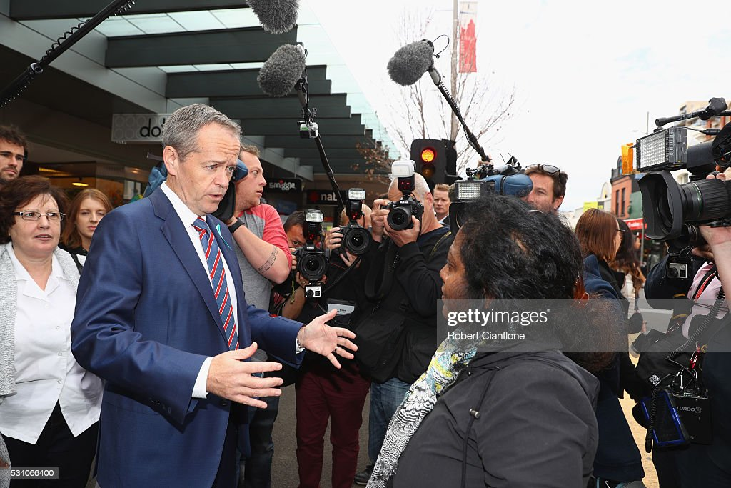 Labour leader <a gi-track='captionPersonalityLinkClicked' href=/galleries/search?phrase=Bill+Shorten&family=editorial&specificpeople=606712 ng-click='$event.stopPropagation()'>Bill Shorten</a> speaks to a locals during a street walk on May 25, 2016 in Melbourne, Australia. A Queensland bank has threatened legal action over Mr Shorten's 'putting people first' campaign slogan, which they believe gives people the impression the bank is affiliated with the Labor party.