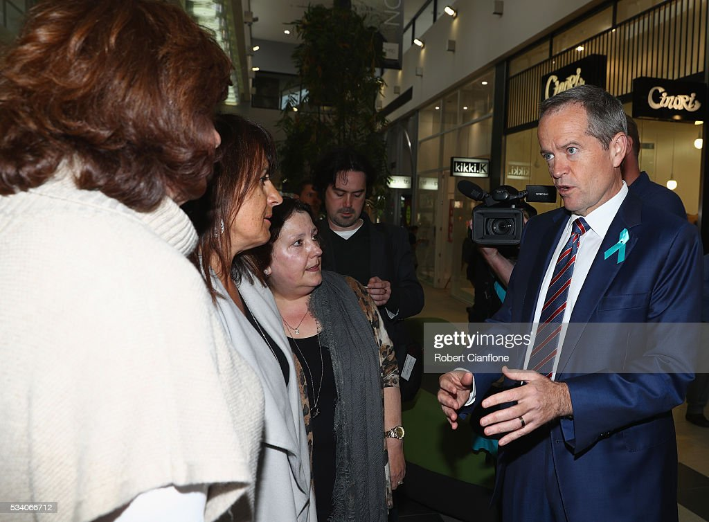Labour leader <a gi-track='captionPersonalityLinkClicked' href=/galleries/search?phrase=Bill+Shorten&family=editorial&specificpeople=606712 ng-click='$event.stopPropagation()'>Bill Shorten</a> speaks to locals during a street walk on May 25, 2016 in Melbourne, Australia. A Queensland bank has threatened legal action over Mr Shorten's 'putting people first' campaign slogan, which they believe gives people the impression the bank is affiliated with the Labor party.