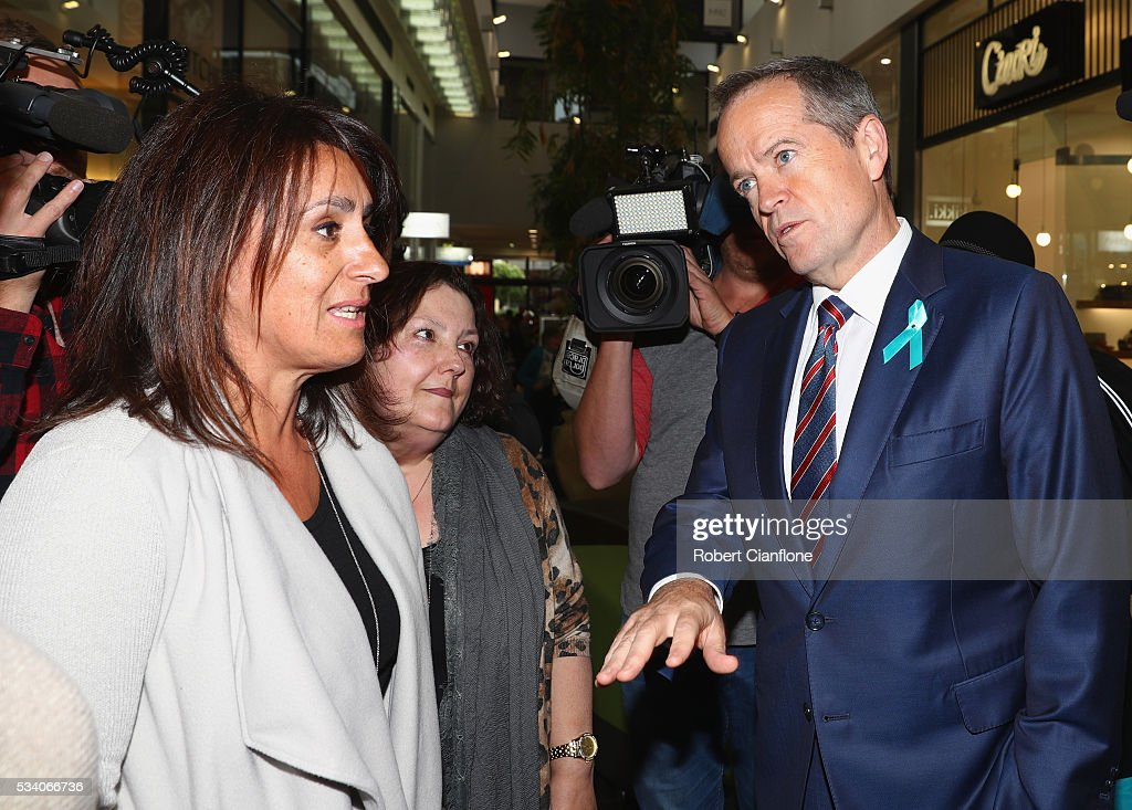 Labour leader Bill Shorten speaks to locals during a street walk on May 25, 2016 in Melbourne, Australia. A Queensland bank has threatened legal action over Mr Shorten's 'putting people first' campaign slogan, which they believe gives people the impression the bank is affiliated with the Labor party.