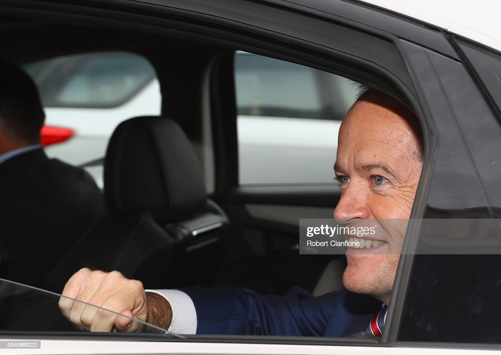 Labour leader <a gi-track='captionPersonalityLinkClicked' href=/galleries/search?phrase=Bill+Shorten&family=editorial&specificpeople=606712 ng-click='$event.stopPropagation()'>Bill Shorten</a> waves to locals as he leaves a street walk on May 25, 2016 in Melbourne, Australia. A Queensland bank has threatened legal action over Mr Shorten's 'putting people first' campaign slogan, which they believe gives people the impression the bank is affiliated with the Labor party.
