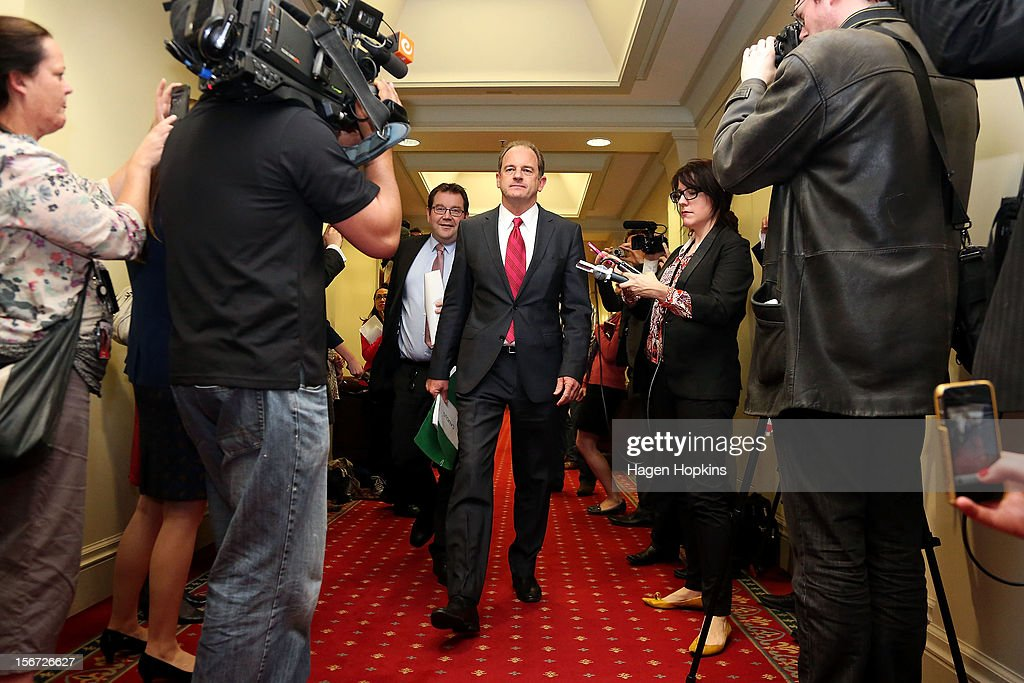 Labour leader David Shearer and deputy leader Grant Robertson pass through waiting media on their way to the caucus room at Parliament on November 20, 2012 in Wellington, New Zealand. Labour party members were called to a leadership vote meeting today after speculation of a leadership challenge by economic development spokesman David Cunliffe.