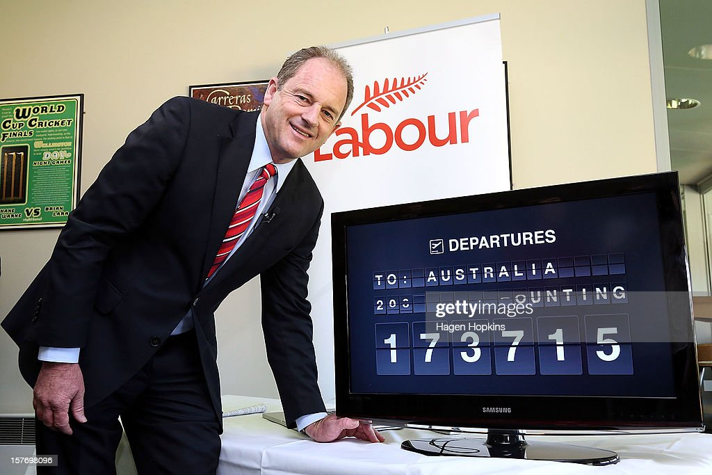 Labour leader David Shearer poses in front of a departures sign counting the number of New Zealanders who have left to live in Australia since 2008 at Westpac Stadium on December 6, 2012 in Wellington, New Zealand. According to Labour's calculations, today will see the 50,000th New Zealander this year board a plane with a one-way ticket for a new life in Australia.