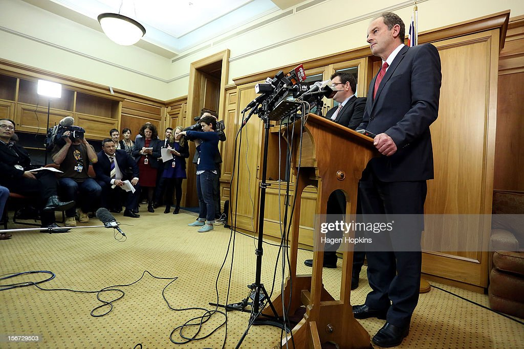 Labour leader David Shearer speaks to media while deputy leader Grant Robertson looks on during a press conference at Parliament on November 20, 2012 in Wellington, New Zealand. David Shearer announced that Labour MP David Cunliffe would be demoted from the front bench to the unranked section of the caucus after speculation of a leadership challenge.