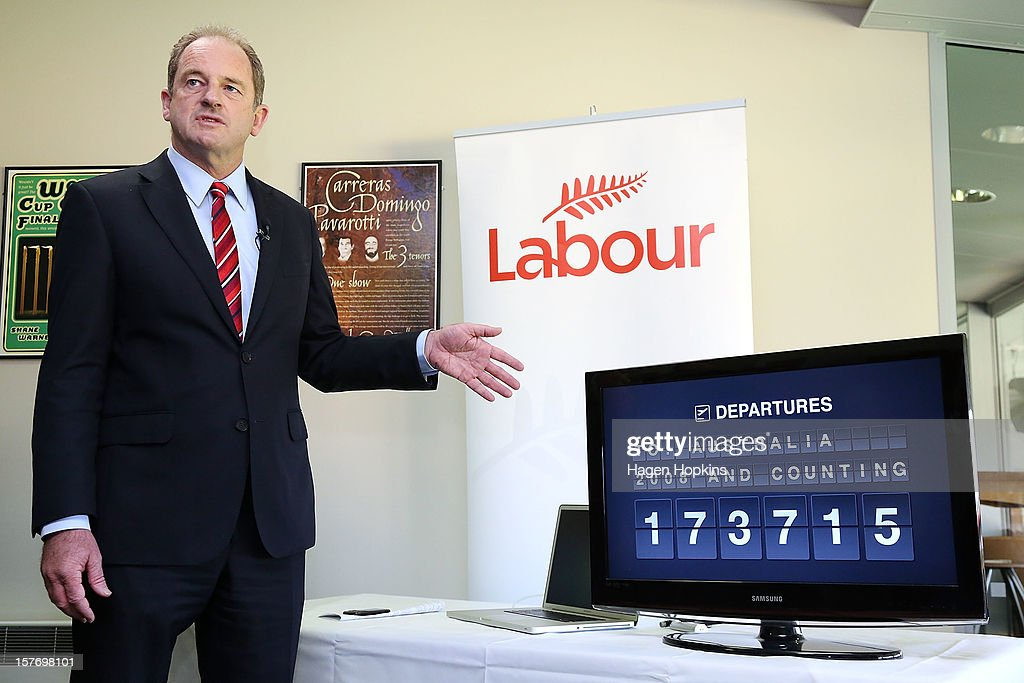 Labour leader David Shearer talks to media in front of a departures sign counting the number of New Zealanders who have left to live in Australia since 2008 at Westpac Stadium on December 6, 2012 in Wellington, New Zealand. According to Labour's calculations, today will see the 50,000th New Zealander this year board a plane with a one-way ticket for a new life in Australia.
