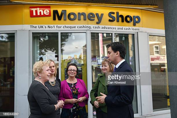 Labour leader Ed Miliband and Harriet Harman Deputy Leader of the Labour Party are greeted by staff of the London Mutual Credit Union in Peckham on...