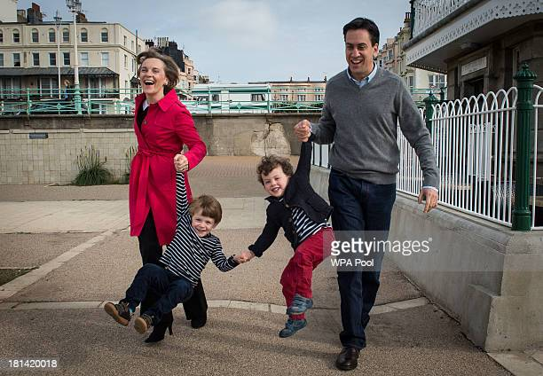 Labour leader Ed Miliband and his wife Justine take their children Daniel and Sam for a walk along Brighton beach on the eve of the Labour Party...