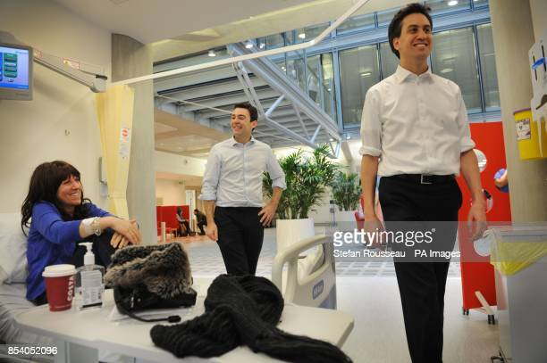 Labour leader Ed Miliband and shadow health secretary Andy Burnham meet patients at the Macmillan Cancer Centre London including cancer patient...