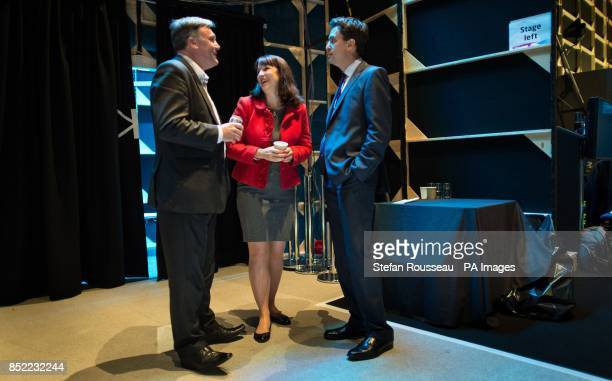 Labour leader Ed Miliband chats with Shadow Chancellor Ed Balls and Shadow Chief Secretary to the Treasury Rachel Reeves backstage during the first...