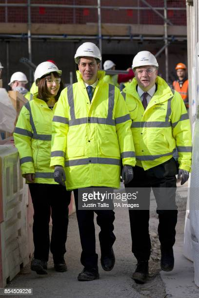 Labour leader Ed Miliband Shadow Chancellor Ed Balls and Shadow Secretary of State for Work and Pensions Rachel Reeves visit the Trafalgar Place...